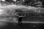 Germany, Hamburg: German riot police use water cannon to disperse protesters during the 'Welcome to Hell' demonstration against the G20 summit in Hamburg, Germany, 6 July 2017. Heavy and violent mass demonstrations took place in several flash points throughout the city as German riot police confronted Anti capitalist and radical left wing groups protesting against the G20 summit in Hamburg, Germany, from 6 to 9 July 2017.