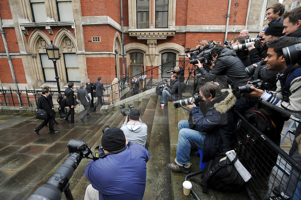 © London News Pictures. 22/11/2011. London, UK.  The media watches Comedian STEVE COOGAN arriving at The Royal Courts of Justice today (22/11/2011) to give evidence at the Leveson Inquiry into press standards. The inquiry is being lead by Lord Justice Leveson and is looking into the culture, and practice of the UK press. The Leveson inquiry, which may take a year or more to complete, comes after The News of The World Newspaper was closed following a phone hacking scandal. Photo credit : Ben Cawthra/LNP