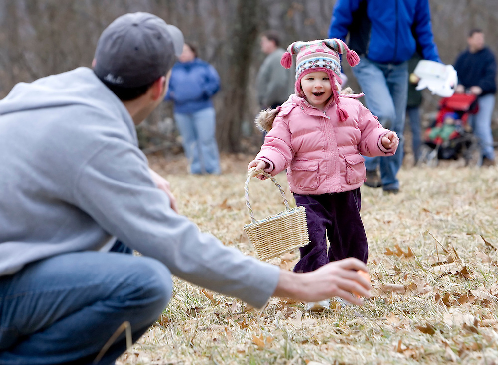 WOODBURY, CT- 16 MARCH 2008- 031608JT03-.Georgia Gehrkens, 2, of Middlebury smiles as her father Peter helps her find an Easter egg at Flanders Nature Center in Woodbury on Sunday during the Family Fun egg hunt..Josalee Thrift / Republican-American