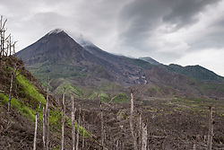 Mt Merapi smoulders throught the destruction of the 2010 eruptions.