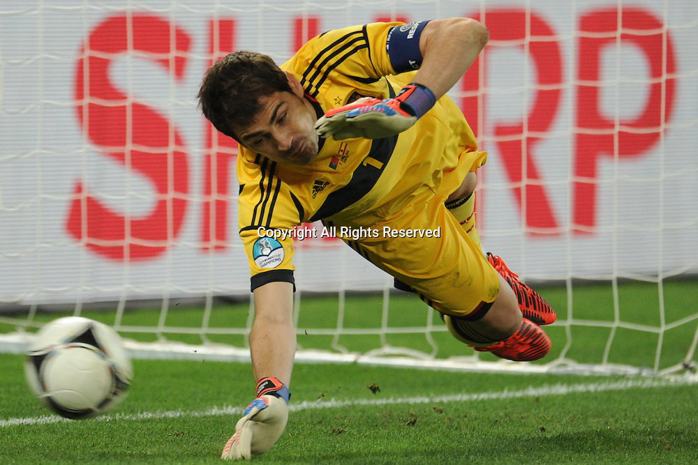 27.06.2012. Donetsk, Ukraine.  Spain's Iker Casillas saves the penalty of Joao Moutinho during UEFA EURO 2012 semi-final soccer match Portugal vs Spain at Donbass Arena in Donetsk, Ukraine, 27 June 2012.