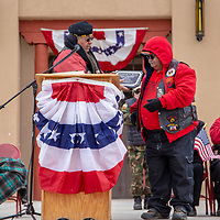 U.S. Marine Corps Vietnam Veteran Leonardo P. Torrez receives a plaque during the Veterans Day ceremony at the courthouse square Monday morning in Gallup.