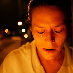 Kyle Green | The Roanoke Times<br /> March 08, 2006 Demetra Goad cries as she remembers her friend, Deborah Vaughn, at a candlelight vigil held Wednesday night at Tinker Creek Manor in Roanoke, Virginia. The vigil was held in honor of Deborah Vaughn and Brenda Wright who were murdered in February.