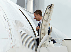 © London News Pictures. 06/06/2012. Luton, UK.  England and Chelsea defender John Terry boarding a plane at Luton Airport in Bedfordshire on June 6, 2012 to head to Poland for the Euro 2012 football tournament. The squads training camp is based in Krakow.  Photo credit: Ben Cawthra/LNP