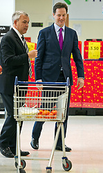 © London News Pictures. 13/11/2013. London, UK. Deputy Prime Minister NICK CLEGG walks past a shopping trolley during a visit to a Tesco store in West London where he met staff and answered questions on the economy. Photo credit: Ben Cawthra/LNP