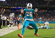 Miami Dolphins running back Damien Williams (26) reacts after his touchdown reception in the second quarter as the Miami Dolphins host the Oakland Raiders at Hard Rock Stadium on Sunday, November 5, 2017.