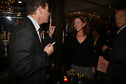 Jeremy Clarke and Katherine Bergen, Drinks party to launch a new Thomas Pink shirt called The Mogul which has a pocket which houses one's cigar. Hostyed by the Spectator and Thomas Pink. Floridita. Wardour St. London. 1 November 2006. -DO NOT ARCHIVE-© Copyright Photograph by Dafydd Jones 66 Stockwell Park Rd. London SW9 0DA Tel 020 7733 0108 www.dafjones.com