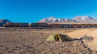 Train passing a tent, Atacama desert, north Chile