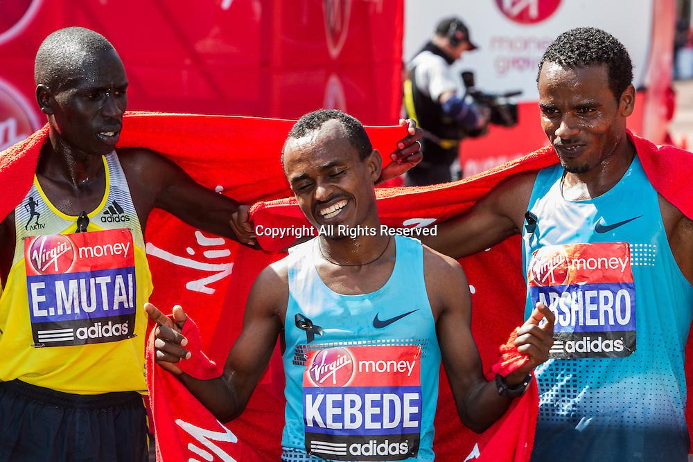 21.04.2013 London, England. Men's winner Tsegaye Kebede (Ethiopia) with Emmanuel Mutai (Ethiopia, left) and Ayele Abshero (Ethiopia, right) during the The Virgin London Marathon.