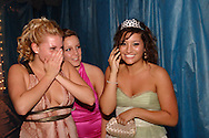 Senior Jennie Maione (right) phones her mother with the news she's been chosen as the prom queen during the Springboro High School prom at Springboro High School, Saturday, April 30, 2011.