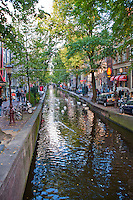Amsterdam, Holland. Canal running through the Red Light District by day.