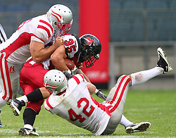 11.07.2011, UPC Arena, Graz, AUT, American Football WM 2011, Group B, Canada (CAN) vs Austria (AUT), im Bild David Stevens (Canada, #35, RB) gets a tackle from Christoph Schreiner (Austria, #42, DB) and Alexander Cucek (Austria, #56, LB)  // during the American Football World Championship 2011 Group B game, Canada vs Austria, at UPC Arena, Graz, 2011-07-11, EXPA Pictures © 2011, PhotoCredit: EXPA/ T. Haumer