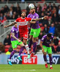 Nathan Baker of Bristol City wins a header above Britt Assombalonga of Middlesbrough - Mandatory by-line: Matt McNulty/JMP - 14/04/2018 - FOOTBALL - Riverside Stadium - Middlesbrough, England - Middlesbrough v Bristol City - Sky Bet Championship