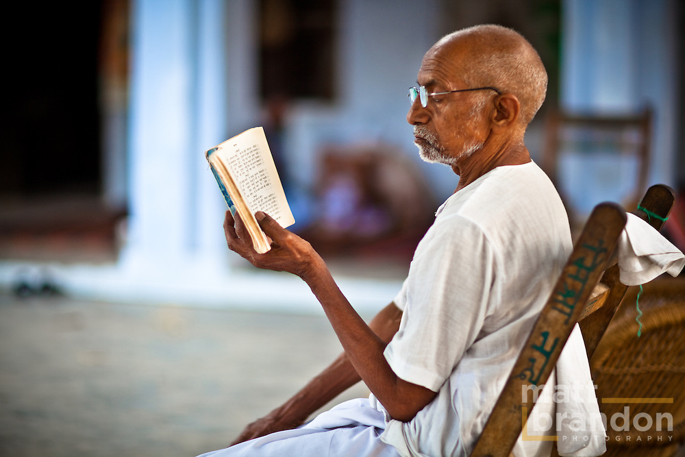 Looking a lot like Ghandi, this old man is reading the vedic scripture.