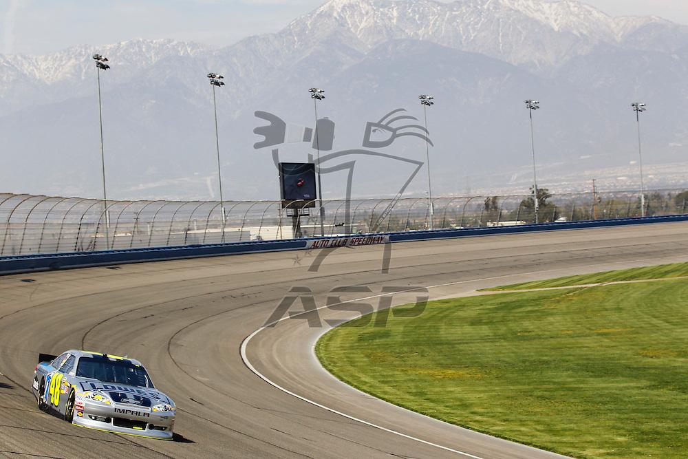 FONTANA, CA - MAR 23, 2012:  Jimmie Johnson (48) brings his car through turn 4 during the Auto Club 400 at the Auto Club Speedway in Fontana, CA.
