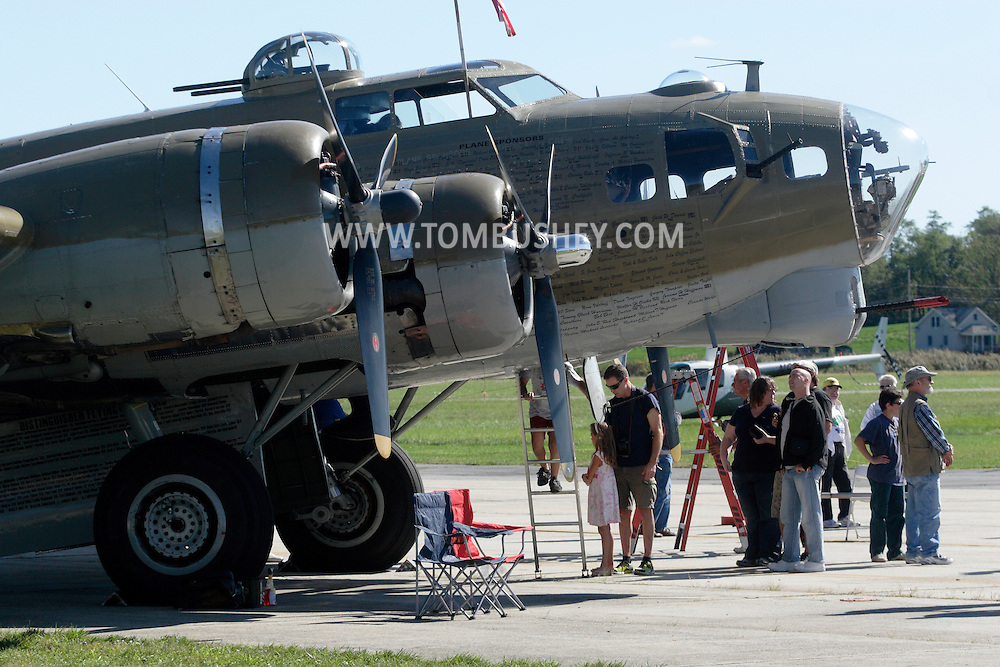 Montgomery, New York -  People line up to climb inside a B-17 Flying Fortress bomber at Orange County Airport on Oct. 2, 2010. Three World War II planes from the Collings Foundation wereon display and available for tours and flights at Orange County Airport on Oct. 2, 2010.