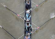 © Licensed to London News Pictures. 17/03/2012. London, UK. Crews participate in the rain today,  Saturday 17th March, in The Head of the River Race which is rowed annually in March from Mortlake to Putney on the River Thames in London.  Over 400 crews of eights take part, making it one of the highest participation events in London.. Photo credit : Stephen SImpson/LNP