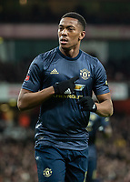 Football - 2018 / 2019 FA Cup - Fourth Round: Arsenal vs. Manchester United <br /> <br /> Anthony Martial (Manchester United) points to his club crest after scoring as he turns away in celebration at The Emirates Stadium.<br /> <br /> COLORSPORT/DANIEL BEARHAM