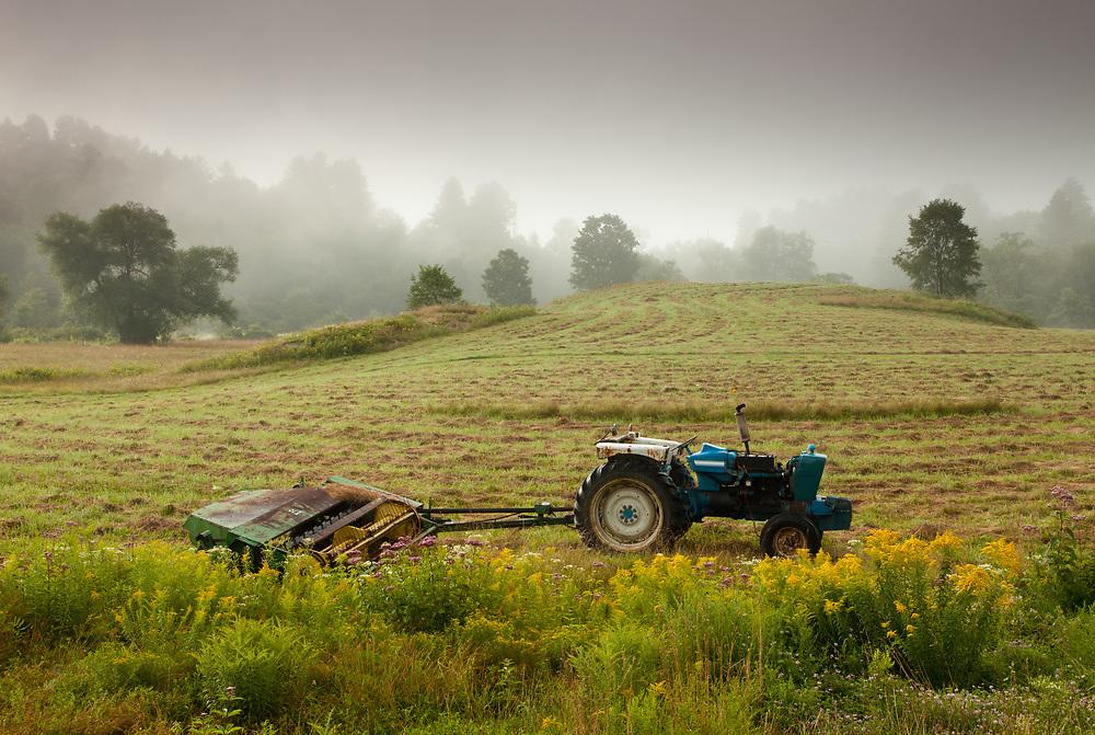 Fog lifts over a summer pasture outside Montpelier, VT.