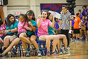 Milpitas High School juniors celebrate landing an open chair during musical chairs against the juniors during the annual Trojan Olympics, where students compete in various unorthodox events for class bragging rights, at Milpitas High School in Milpitas, California, on March 27, 2015. (Stan Olszewski/SOSKIphoto)