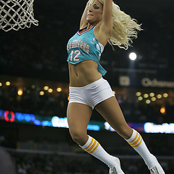 New Orleans Honeybee Brittney flies through the air during the Honeybees dance team dunk competition during a third quarter timeout in the third quarter of the Hornets game against the New York Knicks on April 4, 2008 at the New Orleans Arena in New Orleans, Louisiana. New Orleans Hornets defeated the New York Knicks 118-110 and with the win clinched a NBA Playoff birth.