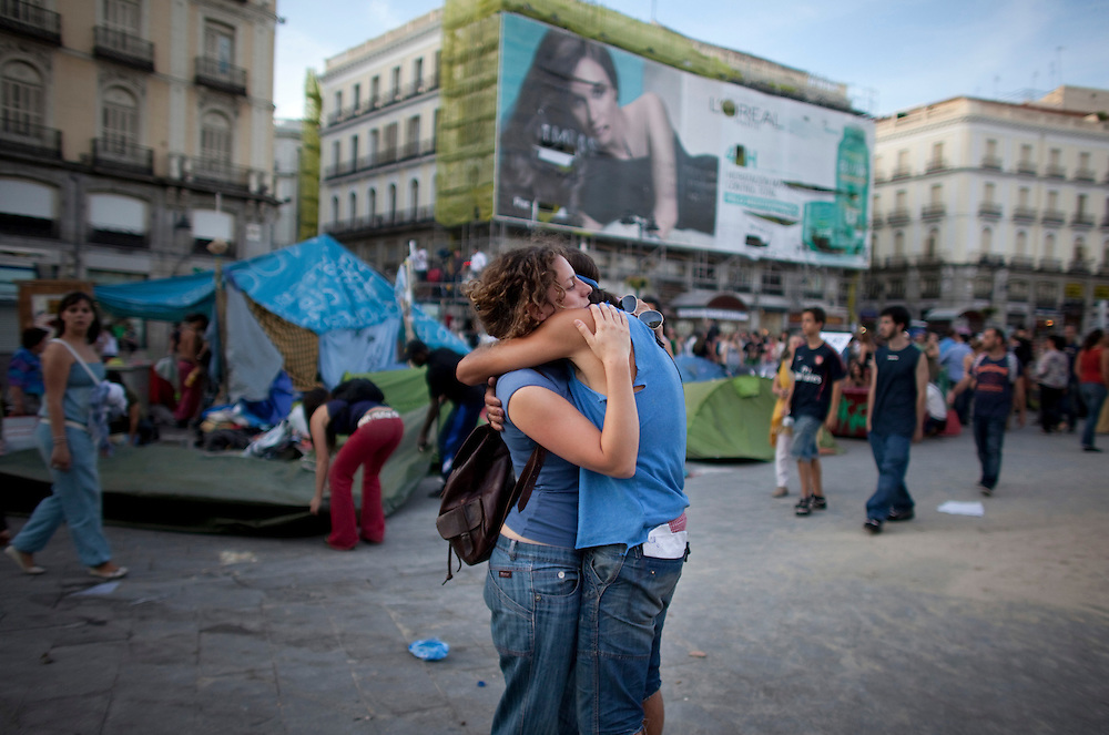 Demonstrators say their goodbyes as they dismantle their camp in Madrid's Puerta del Sol, Sunday, June 12, 2011. Tens of thousands of mostly young people have set up around-the-clock protest camps in cities and town across Spain since May 15 to complain about the government's handling of the economic crisis and what they see as a corrupted political party system.