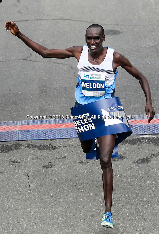 Weldon Kirui of Kenya, crosses the finish line to win the 31st Los Angeles Marathon in Los Angeles, Sunday, Feb. 14, 2016. The 26.2-mile marathon started at Dodger Stadium and finished at Santa Monica.  (Photo by Ringo Chiu/PHOTOFORMULA.com)<br /> <br /> Usage Notes: This content is intended for editorial use only. For other uses, additional clearances may be required.