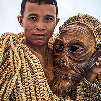 Malaysian indigenous people of the Mah Meri tribe, Daman posed with Bajus mask as he prepare to perform at Aborigine Festival in Kuala Lumpur,  Malaysia 07 June 2014. Mah Meri is one of the aborigines tribe group in Malaysia with about 4,200 members living in Carey Island, Selangor near Kuala Lumpur, Malaysia.