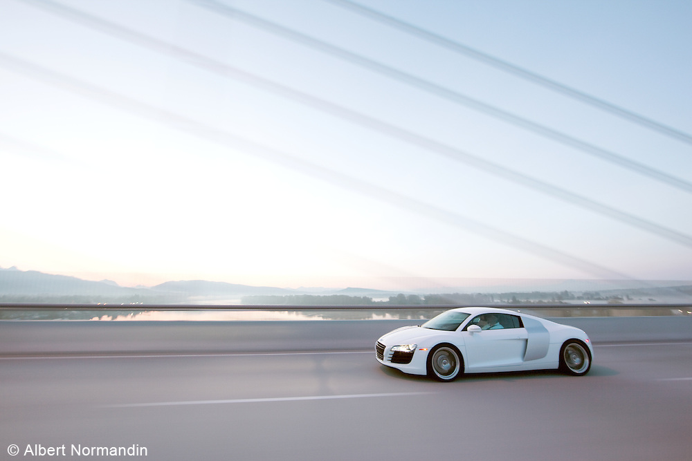 Audi R8 crossing Golden Ears Bridge at speed, before sunrise