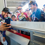 "Daytona, FL - 02/17/2018: Darrell ""Bubba"" Wallace Jr. takes photos with excited fans after his practice for the Daytona 500 in Daytona Beach, Fla. (Willie J. Allen Jr. for ESPN)"