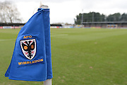 Corner flag displays the AFC Wimbledon Crest  ahead of the Sky Bet League 2 match between AFC Wimbledon and Luton Town at the Cherry Red Records Stadium, Kingston, England on 13 February 2016. Photo by David Vokes.