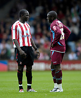 Photo: Jed Wee/Sportsbeat Images.<br /> Scunthorpe United v Sunderland. Pre Season Friendly. 21/07/2007.<br /> <br /> Sunderland's Dwight Yorke (L) with Scunthorpe's Cleveland Taylor.
