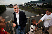 "BETHLEHEM, PA – JUNE 17, 2011: Attorney Fred Rooney lets a group of Hispanic children pass by on the Fahy bridge in Bethlehem, Pennsylvania. Rooney is the founding director of CUNY Law School's Community Legal Resource Network in New York, a virtual law firm that seeks to increase access to justice for people who cannot afford legal help. As Bethlehem native, Rooney attributes the success of the firm to his deep roots in the Hispanic culture of the Lehigh Valley. ""I've been living and breathing it for the greatest part of my life,"" he said. ""I feel very grateful, blessed and fortunate for the things I've learned from the community."" The Fahy bridge connects the historically Hispanic south side of Bethlehem to the predominantly white north."