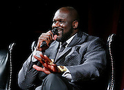 Shaquille O'Neal talks about the day he spent a million dollars, during a panel discussion at the NBA 2K16 Uncensored Premiere Event at Marquee on Monday, September 21, 2015, in New York. (Photo by Stuart Ramson/Invision for 2K/AP Images)