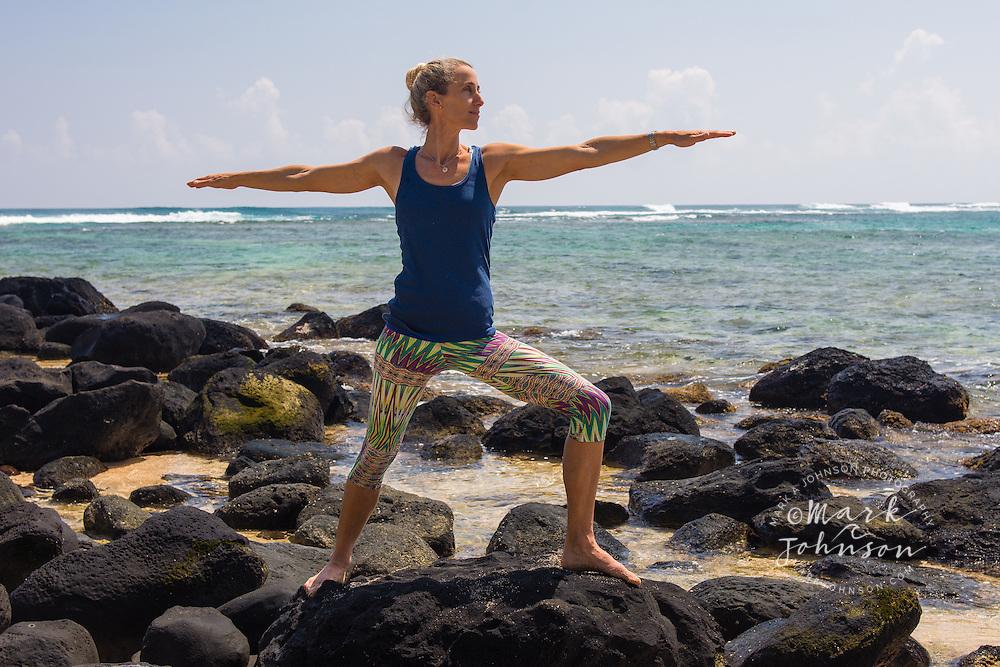 Woman doing yoga on the beach, Hawaii