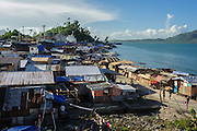 "Barangay 68, often referred to as Yolonda Village by locals, was one of the hardest hit by typhoon Haiyan. After Haiyan devastated the area, the government imposed a ""no build zone"" policy from the waters edge to 40 metres inland, meaning that those who have rebuilt their homes near the ocean face a possible eviction in the future."