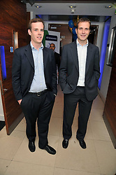 Left to right, VINNY BURGEN and J P MAGNIER at the launch of the 2009 Derby Festival in the presence of HRH Princess Haya of Jordan in aid of the charity Starlight held at the Kensington Roof Gardens, 99 Kensington High Street, London W8 on 12th May 2009.