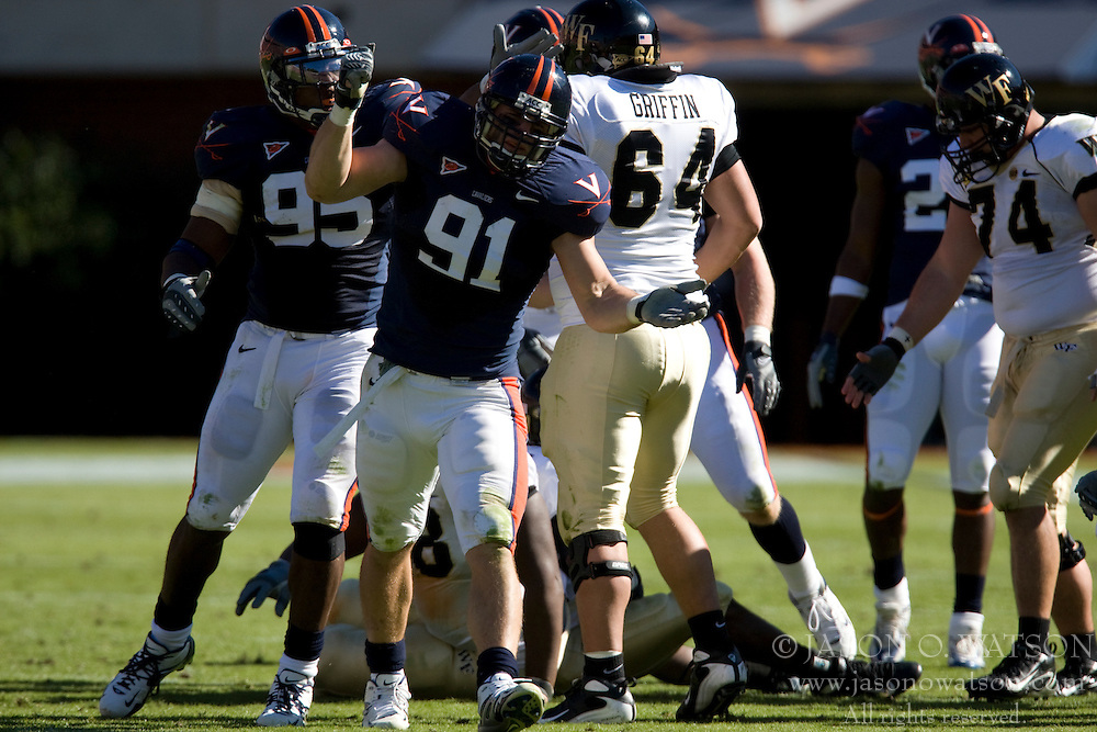 Virginia defensive end Chris Long (91) celebrates after tackling Wake Forest running back Josh Adams (27) for a loss.  The #23 Virginia Cavaliers defeated the #24 Wake Forest Demon Deacons 17-16 at Scott Stadium in Charlottesville, VA on November 3, 2007.