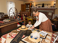Gilford 4th graders learn about the Milliner, Wigmaker and Hatter during their Thompson Ames Historical Society walking field trip to the 1800 Homestead on Thursday morning.  Ginny French (Karen Bobotas/for the Laconia Daily Sun)