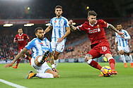Alberto Moreno of Liverpool (r) crosses the ball. Premier League match, Liverpool v Huddersfield Town at the Anfield stadium in Liverpool, Merseyside on Saturday 28th October 2017.<br /> pic by Chris Stading, Andrew Orchard sports photography.