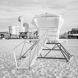 Pensacola Beach Florida lifeguard tower two black and white photo with Casino Beach and the beach ball water tower. Pensacola Beach is on Santa Rosa Island in the Emerald Coast area of the Southeastern United States of America. Photo is vertical and high resolution. Copyright ⓒ 2018 Paul Velgos with All Rights Reserved.