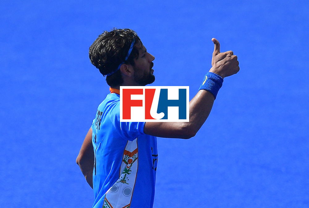India's Rupinder Pal Singh celebrates scoring a goal during the men's field hockey India vs Ireland match of the Rio 2016 Olympics Games at the Olympic Hockey Centre in Rio de Janeiro on August, 6 2016. / AFP / Carl DE SOUZA        (Photo credit should read CARL DE SOUZA/AFP/Getty Images)