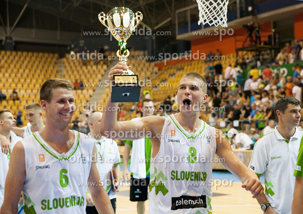 Luka Lapornik of Slovenia and Edo Muric of Slovenia with a trophy for 1st place at Lasko tournament after the friendly match between National teams of Slovenia and Turkey for Eurobasket 2013 on August 4, 2013 in Arena Zlatorog, Celje, Slovenia. (Photo by Vid Ponikvar / Sportida.com)