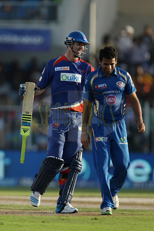 Kevin Pietersen captain of of the Delhi Daredevils and Zaheer Khan of the Mumbai Indians share a light moment during match 16 of the Pepsi Indian Premier League 2014 between the Delhi Daredevils and the Mumbai Indians held at the Sharjah Cricket Stadium, Sharjah, United Arab Emirates on the 27th April 2014<br /> <br /> Photo by Ron Gaunt / IPL / SPORTZPICS