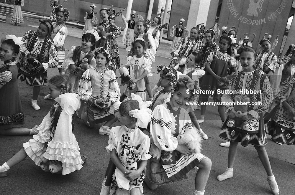 Children in National dress practice their dance routine as part of the build up to National Childrens Day celebrations, in Ala-Too Square, formerly Lenin Square, in Bishkek,  Kyrgyzstan.