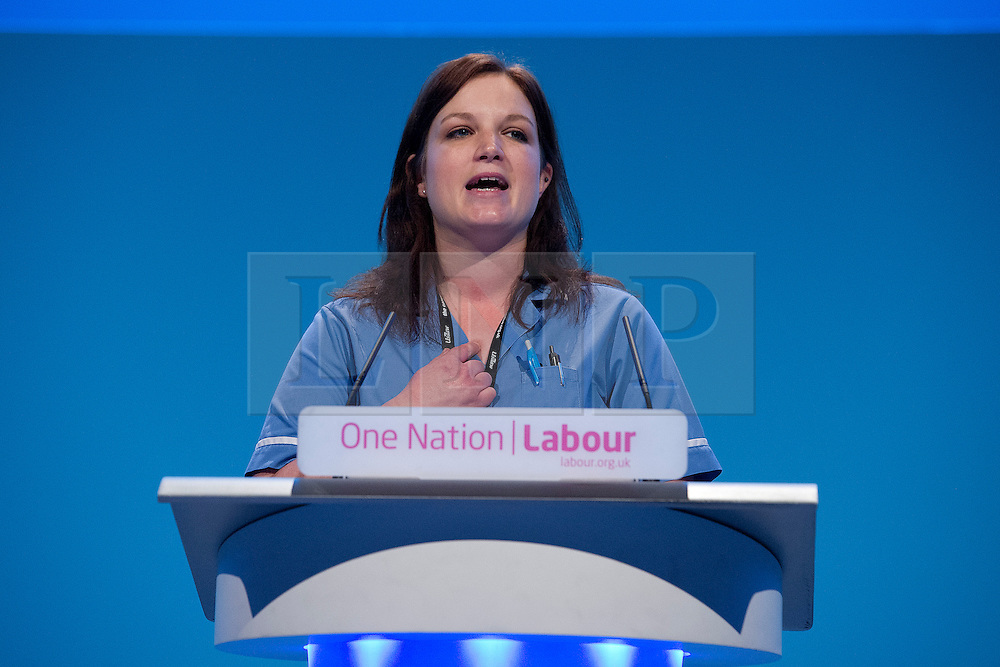 © London News Pictures. 25/09/2013 . Brighton, UK. Care worker Emma Clifford speaking in a motion on the NHS (National Health Service) on the last day of the  2013 Labour Party Conference at The Brighton Centre. Photo credit : Ben Cawthra/LNP