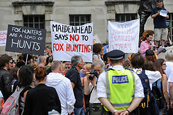 &copy; Licensed to London News Pictures. 29/05/2017. London UK. Demonstrators with signs join an &quot;Anti-Hunting March&quot; in central London, marching from Cavendish Square to outside Downing Street.  Protesters are demanding that the ban on fox hunting remains, contrary to reported comments by Theresa May, Prime Minister, that the 2004 Hunting Act could be repealed after the General Election.<br />  Photo credit : Stephen Chung/LNP
