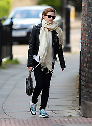 Actress Emma Watson wearing a black leather bikers jacket, white top, cream scarf, skinny jeans a Nike Air Max trainers out in London, UK. 14/05/2014<br />