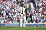 Wicket - Jos Buttler of England looks dejected as he walks back to the pavilion after being dismissed by Pat Cummins of Australia during the 5th International Test Match 2019 match between England and Australia at the Oval, London, United Kingdom on 13 September 2019.