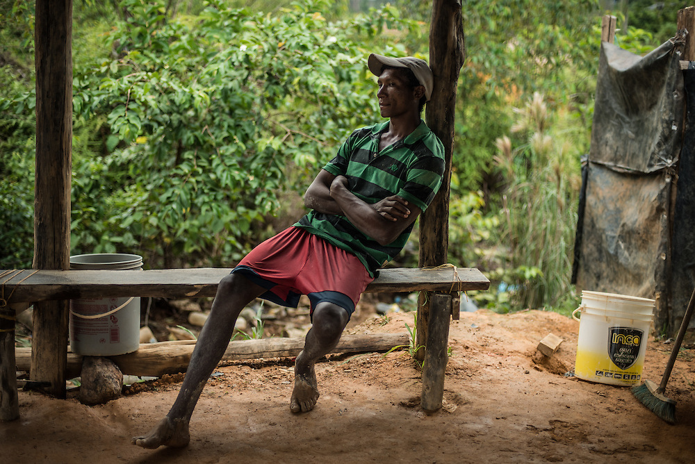 LAS CLARITAS, VENEZUELA - MAY 26, 2016:  Illegal gold miner, Octavio Idriago Reyes, rests at camp during his lunch break at the Albino mine outside of Las Claritas, Venezuela.  Mr. Idriago Reyes has contracted malaria 4 times. Thousands of Venezuelans are flocking to illegal gold mines like this one in hopes of surviving the current economic crisis by earning in gold instead of the national currency, whose value steadily falls due to the world's highest inflation.  From this remote part of the jungle the migrant miners have become the vectors of a new epidemic of malaria, because the hot, swampy conditions of the mines make for an ideal breeding ground for mosquitos. Miners spread the disease as they return home with earnings or pay visits to family members.  The economic crisis has also left the government without the financial resources to control the disease - they are unable to fumigate homes, provide medicines to everyone that is sick, or even to test all patients with symptoms of malaria in many places. PHOTO: Meridith Kohut for The New York Times